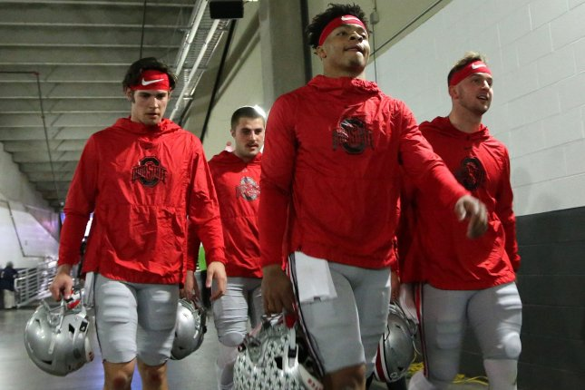 Ohio State Buckeyes quarterback Justin Fields (C) and his teammates were allowed to return to campus June 8 for voluntary workouts. File Photo by Aaron Josefczyk/UPI