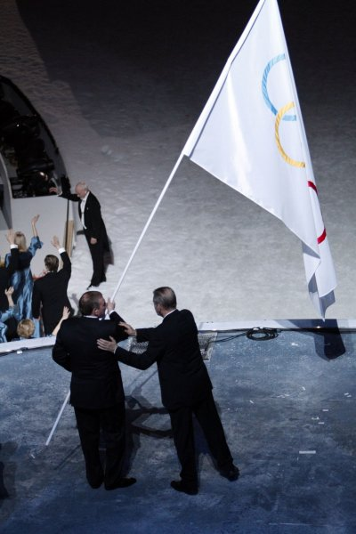 Mayor of Sochi Anatoly Pakhomov, left, receives the Olympic flag from International Olympic Committee (IOC) President Jacques Rogge during the Closing Ceremony at BC Place in Vancouver, Canada, during the 2010 Winter Olympics on February 28, 2010. Sochi will host the 2014 Winter Olympics. UPI/Brian Kersey