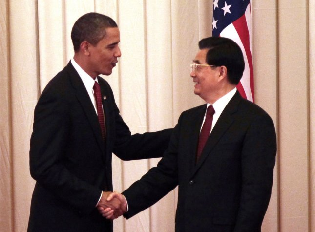 U.S. President Barack Obama (L) and China's President Hu Jintao attend a joint press conference in the Great Hall of the People in Beijing on November 17, 2009. The major challenges of the 21st Century from climate change to nuclear proliferation to economic recovery are challenges that touch both our nations, and challenges that neither of our nations can solve by acting alone, Obama said. UPI/Stephen Shaver