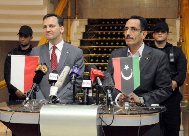 Abdul Hafiz Ghoqa, spokesman of the Libyan National Transitional Council (NTC) with Polish Foreign Minister Radoslaw Sikorski in the eastern rebel stronghold of Benghazi on May 11, 2011 The NTC is now seeking to open an embassy in Washington. UPI\Tarek Alhuony.