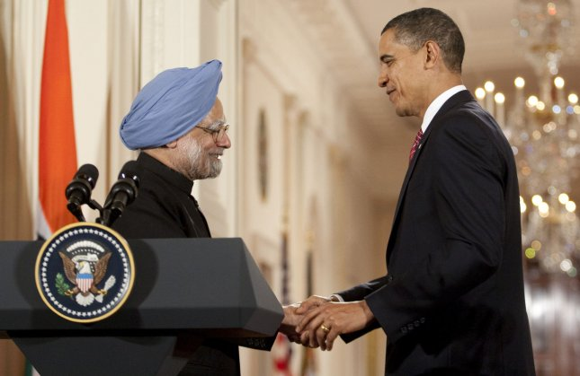 U.S. President Barack Obama (R) shakes hands with Indian Prime Minister Manmohan Singh following their joint press conference at the White House in Washington, November 24, 2009. UPI/Andrew Harrer/Pool