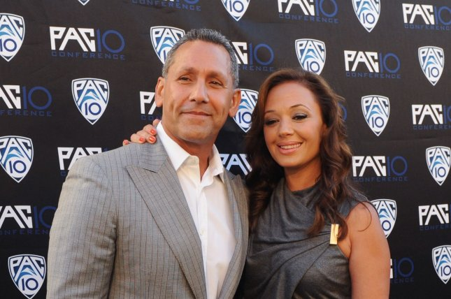 Actors and husband and wife Angelo Pagan (L) and Leah Remini attend FOX Sports/PAC-10 Conference Hollywood premiere night at 20th Century FOX Studios in Los Angeles on July 29, 2010. File photo by Jim Ruymen/UPI