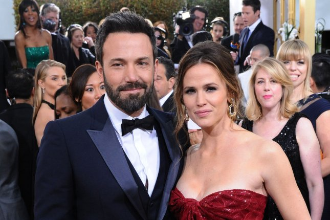 Ben Affleck (L) and Jennifer Garner at the Golden Globe Awards on January 13, 2013. The former couple will reportedly move into Brooke Shields' home as their house undergoes renovations. File photo by Jim Ruymen/UPI
