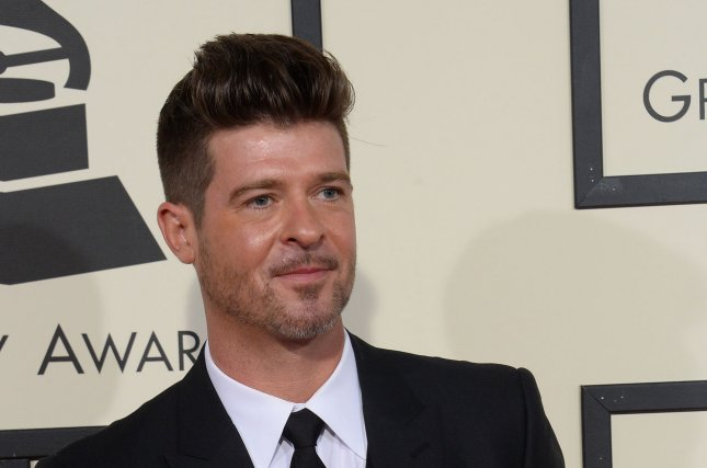 Robin Thicke arrives for the 58th annual Grammy Awards held at Staples Center in Los Angeles on February 15, 2016. Thicke, Pharrell Williams and Clifford Harris Jr., also known as T.I., filed an appeal to overturn a ruling that their song Blurred Lines infringed on a copyright of Marvin Gaye's Got to Give It Up. Photo by Jim Ruymen/UPI