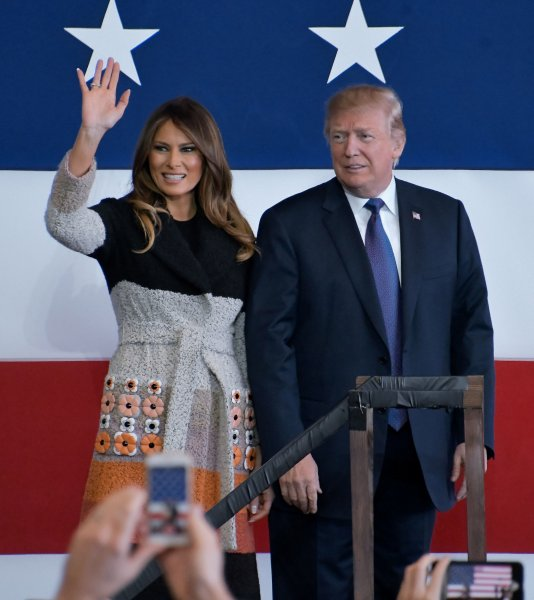 U.S. President Donald Trump and first lady Melania arrive on the stage for his speech at the Yokota Air Base in Tokyo on Sunday. Photo by Keizo Mori/UPI