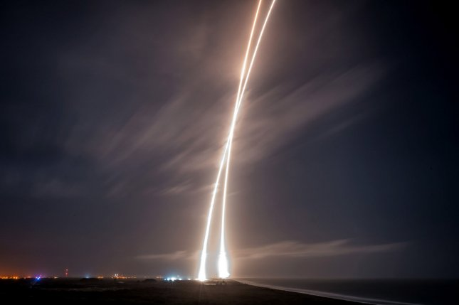 This long exposure shows the launch of the SpaceX Falcon 9 rocket and the safe return of the first stage of the rocket at Cape Canaveral, Fla., on December 21, 2015. File Photo courtesy of SpaceX