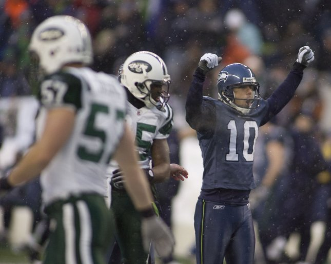 Seattle Seahawks kicker Olindo Mare (R) celebrates his 38-yard field goal against the New York Jets in the fourth quarter at Qwest Field in Seattle on December 21, 2008.Mare also kicked a 31-yard field goal in the third quarter as the Seahawks beat the Jets 13-3. (UPI Photo/Jim Bryant)