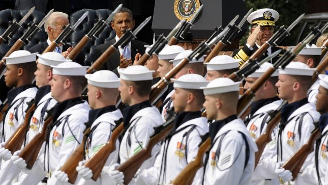 Vice President Joe Biden, U.S. President Barack Obama and outgoing Chairman of the Joint Chiefs of Staff Adm. Michael Mullen watch as the Navy Honor Guard passes in review during the Chairman of the Joint Chiefs of Staff Farewell Review and Change of Responsibility Ceremony at Joint Base Myer-Henderson Hall's Summerall Field in Arlington, Virginia, on September 30, 2011. Navy Adm. Mike Mullen, 17th chairman, Joint Chiefs of Staff, transitioned responsibility to Army Gen. Martin E. Dempsey. UPI/Roger L. Wollenberg