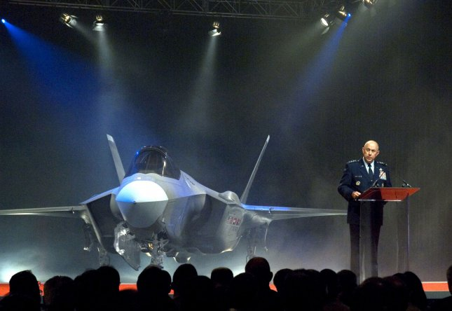 Air Force Chief of Staff Gen. T. Michael Moseley announces Lightning II as the name selected for the new Lockheed Martin F-35 during the inauguration ceremony at the Lockheed Martin plant in Fort Worth, Texas on July 7, 2006. (Image photo/Lockheed Martin)