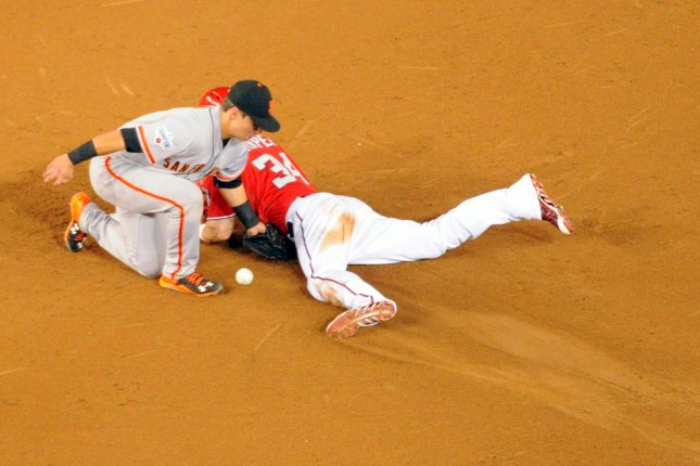 Washington Nationals right fielder Bryce Harper (34) steals second base as San Francisco Giants second baseman Joe Panik (12) cannot handle the throw in the third inning at Nationals Park in Washington, D.C. on July 5, 2015. Photo by Mark Goldman/UPI
