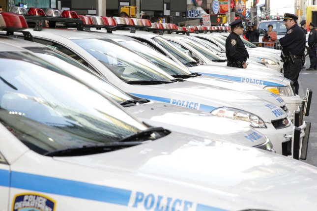 Two NYPD officers were shot early Saturday by a suspect with whom they were engaged in a car chase. Both are in stable condition and are expected to survive. File Photo by John Angelillo/UPI