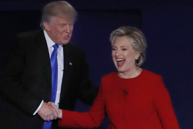 Democrat Hillary Clinton and Republican Donald Trump greet each other after the first presidential debate at Hofstra University in Hempstead, N.Y. Clinton retook the lead in the UPI/CVoter daily presidential tracking poll with the first data reported since her strong debate performance. Photo by John Angelillo/UPI