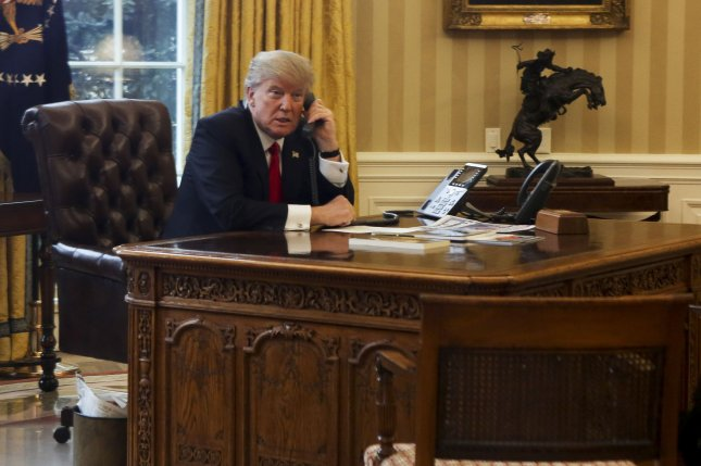 President Donald Trump, seen here speaking with the King of Saudi Arabia, Salman bin Abd al-Aziz Al Saud, by telephone on January 29, said he will announce his Supreme Court nomination on Tuesday morning. Pool Photo by Aude Guerrucci/UPI