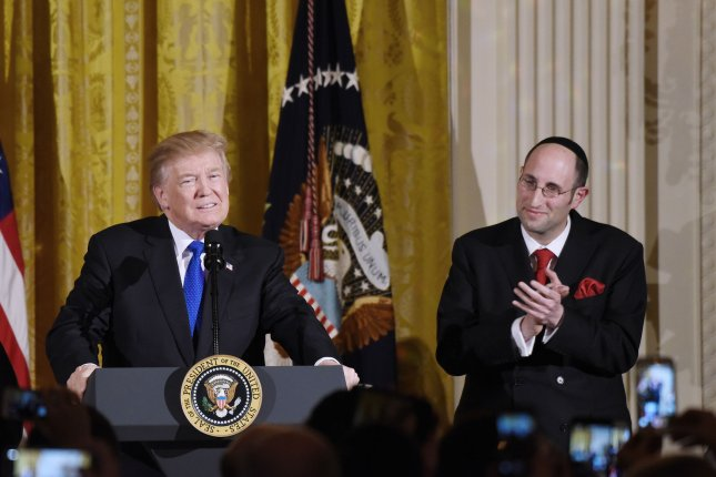 President Donald Trump hosted his first White House Hanukkah party, which included guests like Rabbi Meir Yaakov Soloveichik, of America's first Jewish congregation. Photo by Olivier Douliery/UPI
