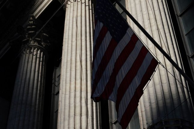 The flag of the United States hangs outside the New York Stock Exchange Thursday on Wall Street in New York City. Photo by John Angelillo/UPI
