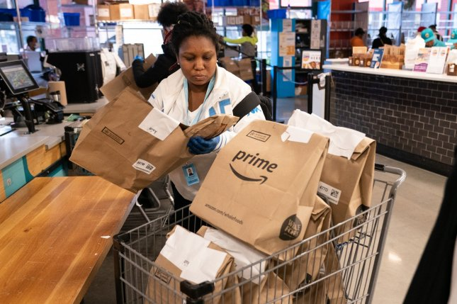 An independent contractor places Amazon Prime groceries into a cart at a Whole Foods Market in Silver Spring, Md., on March 31. File Photo by Kevin Dietsch/UPI