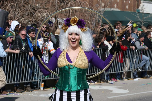 A woman performs with a Hula Hoop as she walks in the St. Louis Mardi Gras Parade on February 22. Photo by Bill Greenblatt/UPI