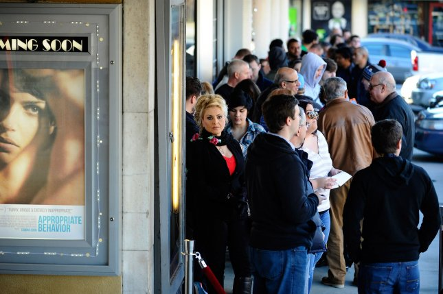 Moviegoers line up to enter the historical Plaza Theatre for the 4:00 p.m. showing of the movie The Interview as it opens locally at the independent theater on Christmas Day, December 25, 2014, in Atlanta. Theater owner Michael Furling said the two-screen cinema would have screenings at 4:00 p.m., 5:00 p.m., 6:30 p.m., 7:30 p.m. and 9:35 p.m. on opening day. UPI/David Tulis