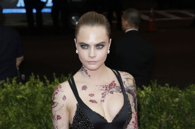 Cara Delevingne at the Costume Institute Benefit at the Metropolitan Museum of Art on May 4, 2015. The model said she finds most superhero movies sexist in a new interview. File photo by John Angelillo/UPI
