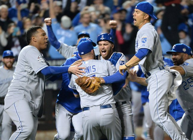Kansas City Royals closer Wade Davis, catcher Drew Butera, Salvador Perez (L) and Alex Gordon (R) celebrate winning the 2015 World Series on Nov. 2. The Royals are underdogs to repeat this year, but coaches say that's only motivated them more. File photo by Pat Benic/UPI