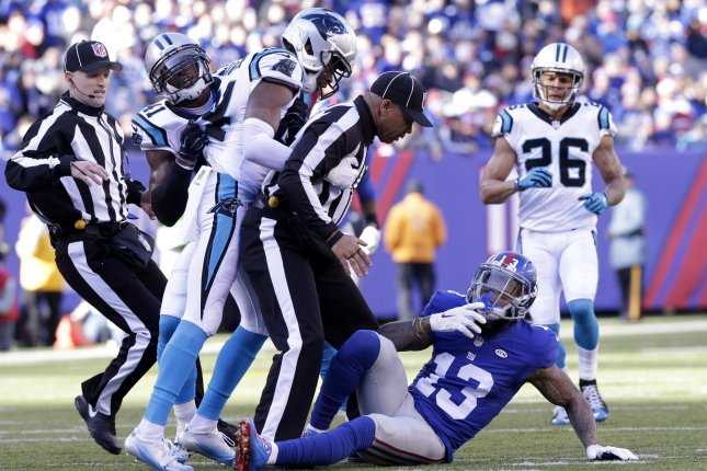 New York Giants' Odell Beckham Jr. ends up on the after an altercation with and Carolina Panthers' Josh Norman in the first quarter at MetLife Stadium in East Rutherford, New Jersey on December 20, 2015. The Panthers defeated the Giants 38-35 and remain undefeated at 14-0. Photo by John Angelillo/UPI
