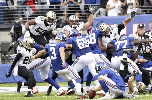 New York Giants Josh Brown kicks a game winning field goal in the 4th quarter against the New Orleans Saints in week 2 of the NFL at MetLife Stadium in East Rutherford, New Jersey on September 18, 2016. The Giants defeated the Saints 16-13. Photo by John Angelillo/UPI