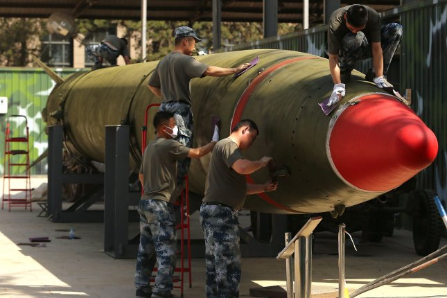 Chinese soldiers touch-up a decommissioned Dongfeng-2 medium range ballistic missile on display at the Chinese Military Museum of the People's Revolution in Beijing on April 29. China recently tested an unidentified missile, according to a statement from Beijing's defense ministry. Photo by Stephen Shaver/UPI
