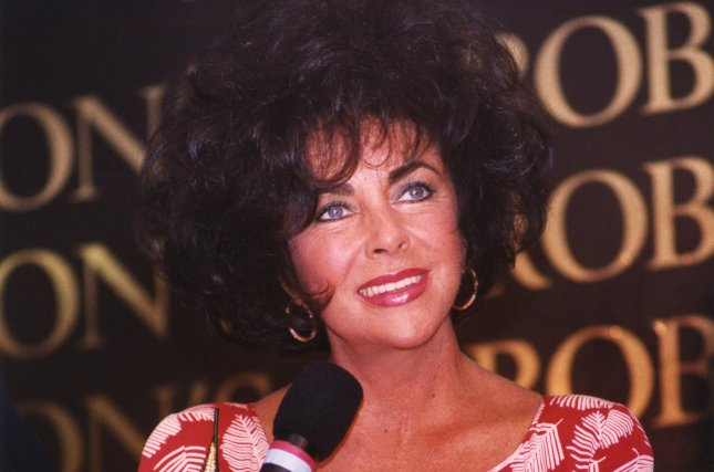 Elizabeth Taylor, making her first appearance since marrying for the eighth time four days earlier, holds a press conference to promote her new fragrance White Diamonds in Torrence, Calif., on October 10, 1991. Many reporters asked questions about Taylor's wedding, held at Michael Jackson's ranch. File Photo by Jim Ruymen/UPI