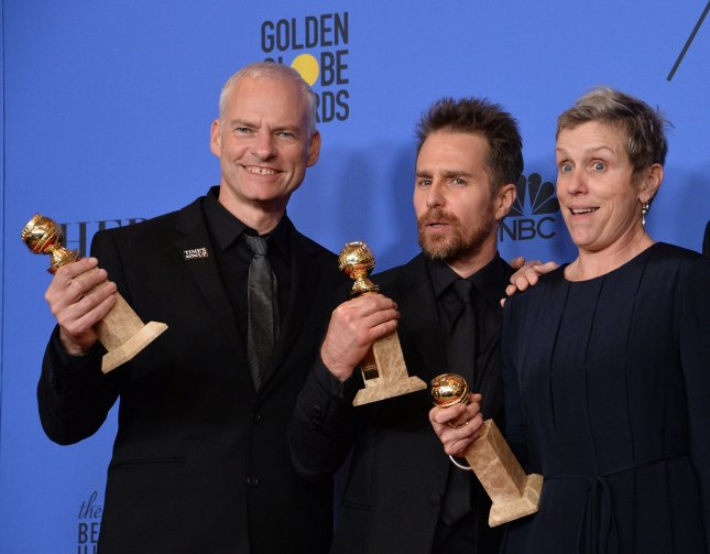 Director Martin McDonagh, actors Sam Rockwell and Frances McDormand (L-R) appear backstage after winning the award for Best Motion Picture - Drama for 'Three Billboards Outside Ebbing, Missouri' during the 75th annual Golden Globe Awards on January 7. Photo by Jim Ruymen/UPI