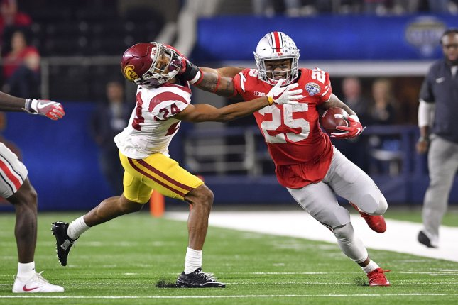 Ohio State Buckeyes running back Mike Weber stiff arms USC Trojans cornerback Isaiah Langley in the Goodyear Cotton Bowl Classic on December 29 at AT&T Stadium in Arlington, Texas. Photo by Shane Roper/UPI