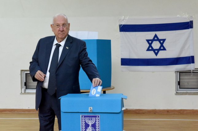 Israeli President Reuven Rivling votes during Israel's parliamentary election at a polling station in Jerusalem, Israel, on March 2. Photo by Debbie Hill/UPI