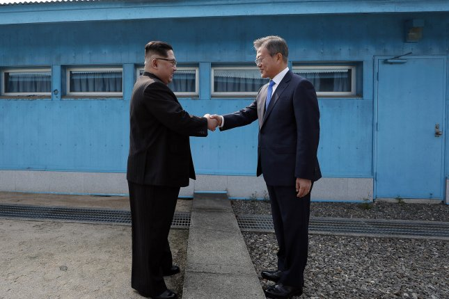 South Korean President Moon Jae-in (R) has previously said that COVID-19 vaccine diplomacy could be a means of persuading North Korea to return to the table. File Photo by Inter-Korean Summit Press Corps/UPI