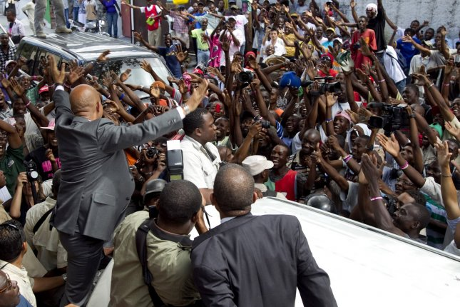 Michel Martelly, the early winner of Haiti's presidential elections, greets jubilant crowds before delivering a press conference in Port-au-Prince, Haiti on April 5, 2011. Preliminary electoral results released a day earlier showed Mr. Martelly had captured 68 percent of the vote, placing ahead of former First Lady Mirlande Manigat. UPI/Logan Abassi/UN