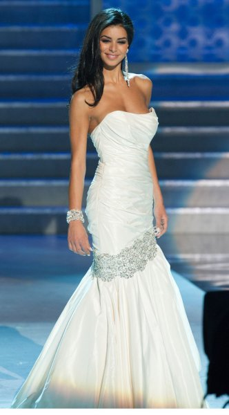 Rima Fakih, Miss Michigan USA 2010, poses for the judges during the final vote at the MISS USA 2010 competition in Las Vegas, Nevada on May 16, 2010. The Lebanese-American woman became the first of Arab descent to be crowned Miss USA. (EDITORIAL USE ONLY-NO USE AFTER 60 DAYS) UPI/Darren Decker/HO-Miss Universe L.P., LLLP.