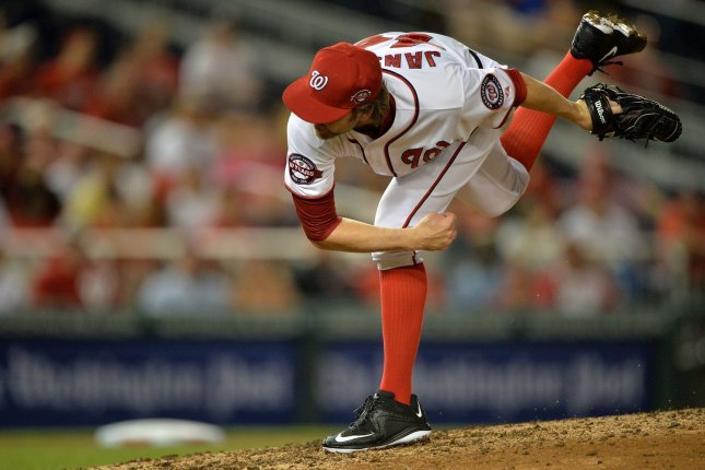 Former Washington Nationals pitcher Casey Janssen pitches against the Cincinnati in the eighth inning at Nationals Park in Washington, D.C. on July 6, 2015. Photo by Kevin Dietsch/UPI