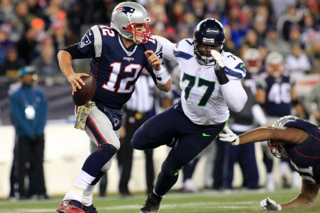 New England Patriots quarterback Tom Brady (12) scrambles to avoid a sack by Seattle Seahawks defensive tackle Ahtyba Rubin (77) in the second quarter at Gillette Stadium in Foxborough, Massachusetts on November 13, 2016. Photo by Matthew Healey/ UPI
