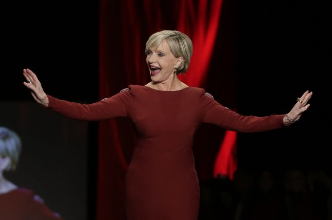 Florence Henderson walks the runway at The American Heart Association's Go Red For Women Red Dress Collection 2016 during New York Fashion Week on Feb. 11 in New York City. Henderson died Thursday at the age of 82. File Photo by John Angelillo/UPI