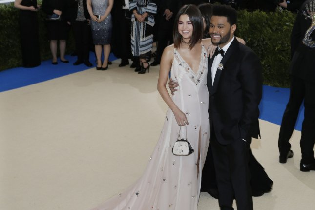 Selena Gomez (L) and The Weeknd attend the Costume Institute Benefit at the Metropolitan Museum of Art on May 1. The actress discussed going public with The Weeknd on On Air with Ryan Seacrest. File Photo by John Angelillo/UPI