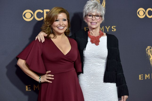 Actresses Justina Machado (L) and Rita Moreno arrive for the Primetime Emmy Awards in Los Angeles in September. Their Netflix sitcom One Day at a Time is now streaming. File Photo by Christine Chew/UPI