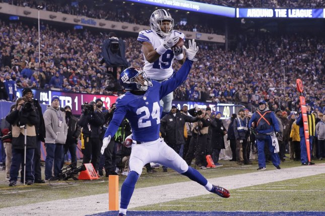 New York Giants cornerback Eli Apple (24) defends Dallas Cowboys wide receiver Brice Butler, who drops a pass near the end zone in the first quarter in Week 14 of the NFL season on December 11, 2016 at MetLife Stadium in East Rutherford, New Jersey. File photo by John Angelillo/UPI