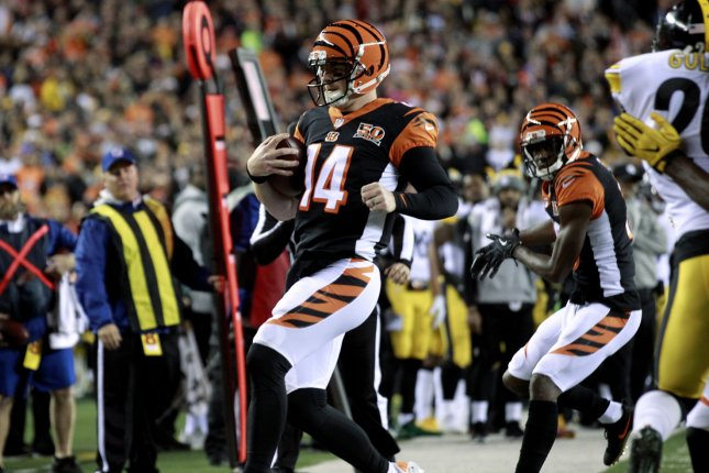Cincinnati Bengals quarterback Andy Dalton (14) runs for the first down under pressure from the Pittsburgh Steelers' defense during the first half of play on December 4, 2017 at Paul Brown Stadium in Cincinnati. Photo by John Sommers II/UPI