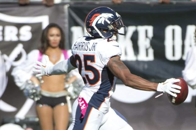 Denver Broncos defensive back Chris Harris Jr. runs down the sidelines en route to a 74-yard touchdown during a game against the Oakland Raiders. Photo by Terry Schmitt/UPI
