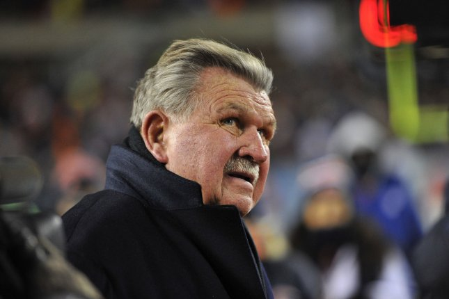 Former Chicago Bears tight end, head coach and Pro Football Hall of Famer Mike Ditka watches a tribute video during a halftime ceremony retiring his number on December 9, 2013 at Soldier Field in Chicago. File photo by Brian Kersey/UPI