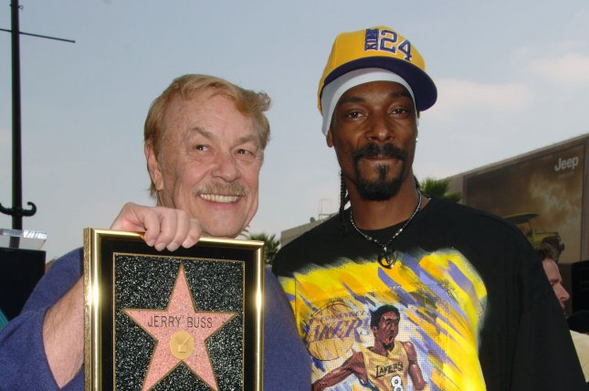 Rapper Snoop Dogg (right) is a lifelong Los Angeles Lakers fan and had a strong relationship with the team's late owner, Dr. Jerry Buss. File Photo by Jim Ruymen/UPI