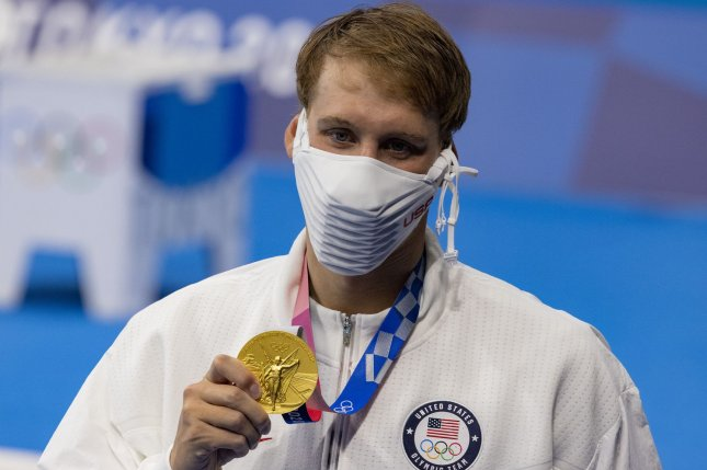 Team USA swimmer Chase Kalisz shows off his gold medal after winning the men's 400-meter individual medley at the 2020 Summer Games on Sunday at the Tokyo Aquatics Center in Tokyo. Photo by Tasos Katopodis/UPI