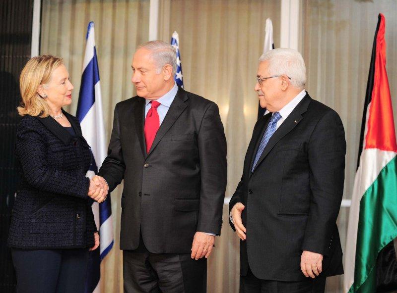 Palestinian President Mahmoud Abbas (R), shown with U.S. Secretary of State Hillary Clinton and Israeli Prime Minister Binyamin Netanyahu in Jerusalem Sept. 9, 2010. UPI