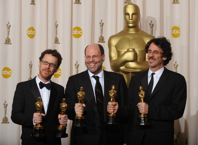 Ethan Coen, Scott Rudin and Joel Coen (L to R) pose with their Oscars for Best Director and Best Picture for No Country for Old Men at the 80th Annual Academy Awards at the Kodak Theatre in Hollywood, California on February 24, 2008. (UPI Photo/Jim Ruymen)