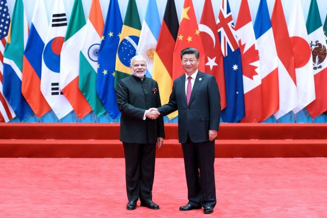 Indian Prime Minister Narendra Modi and Chinese President Xi Jinping have established friendly ties, but the two countries continue to strengthen their military at the border. File Pool Photo by Ma Zhancheng /UPI