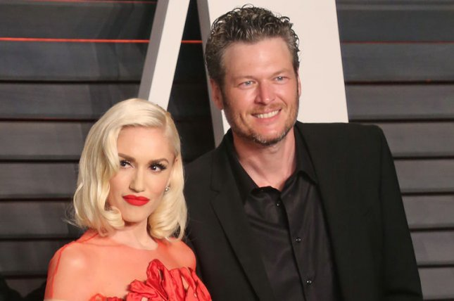 Gwen Stefani (L), pictured with Blake Shelton, thanked the country star following an outing at Lake Texoma. File Photo by David Silpa/UPI