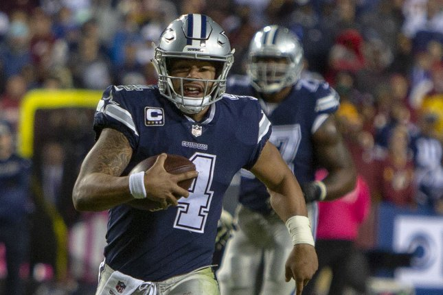 Dallas Cowboys quarterback Dak Prescott takes off running during a game against the Washington Redskins at FedEx Field in Landover, Maryland on October 21 2018. Photo by Tasos Katopodis/UPI